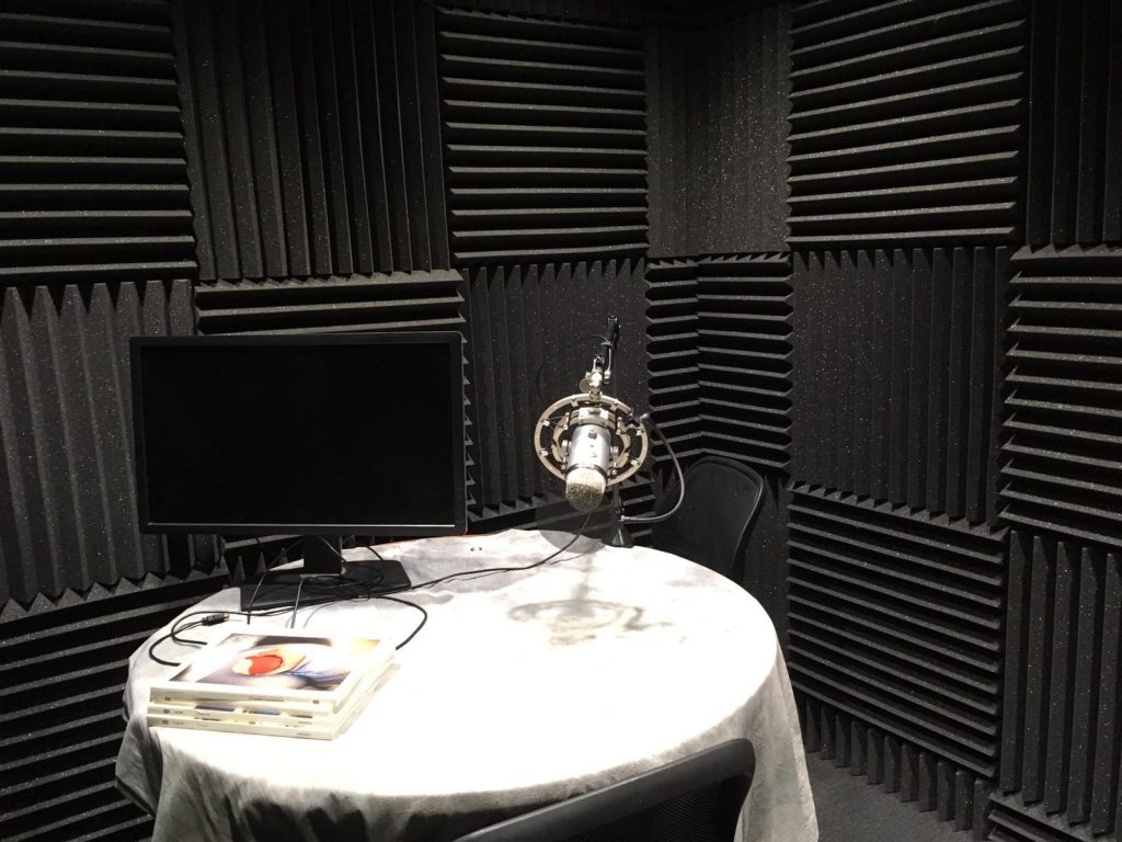 Recording booth with microphone and table