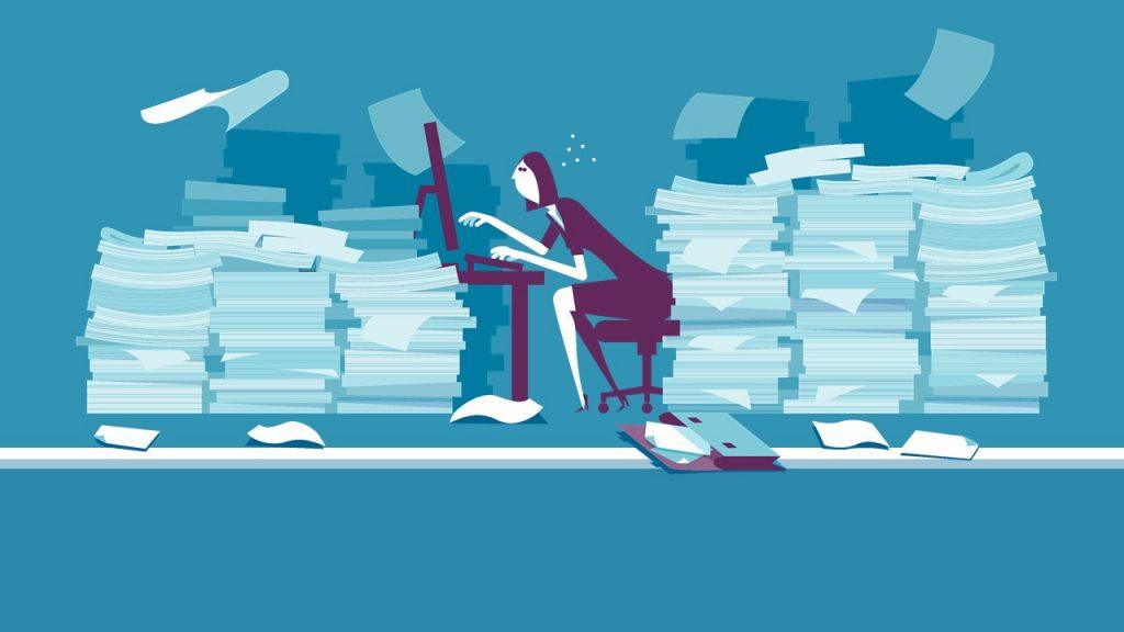 Illustration of woman sitting between piles of paperwork