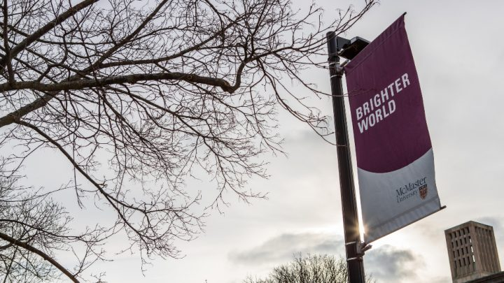 Photo of McMaster Brighter World banner from campus