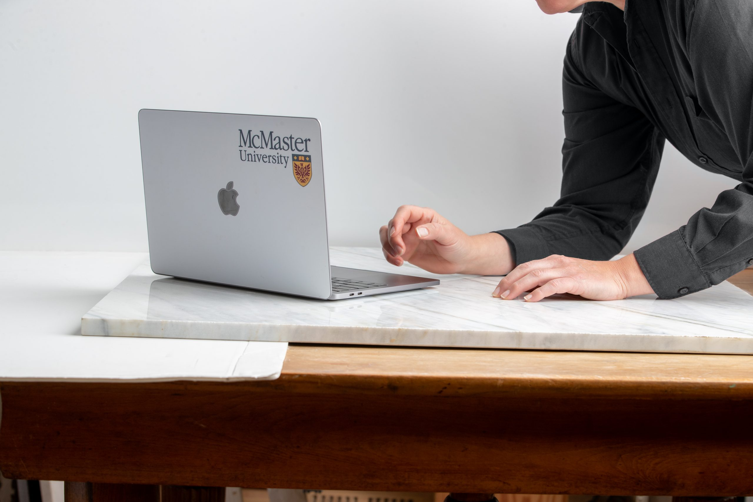 Student typing on laptop